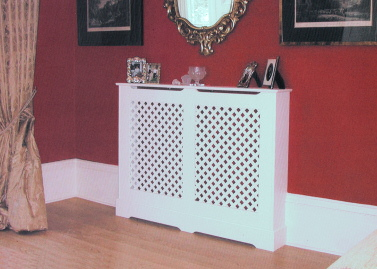 Radiator cover with a double panel painted cover with a painted single overlaid lattice. This radiator cover hides an unsightly radiator in an otherwise elegant room.